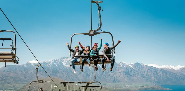 4 Friends Riding The Skyline Queenstown Luge Chairlift To The Start Of The Tracks.