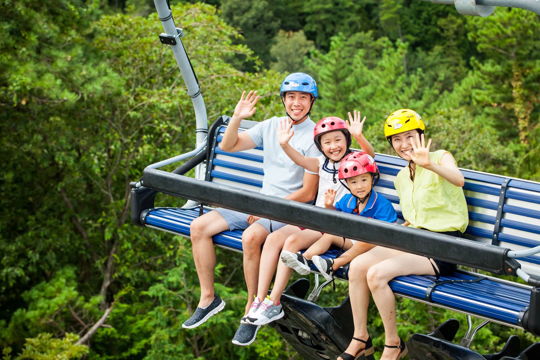 A Family Of Four Rides The Skyride To The Top Of The Luge.